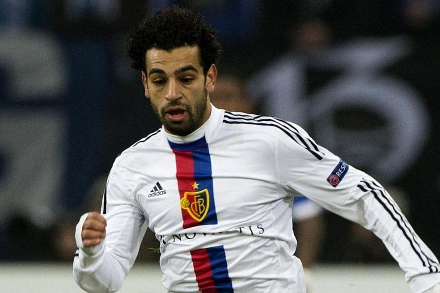 Former Basel Egyptian midfielder Mohamed Salah runs with the ball during the Uefa Champions League group E football match FC Schalke 04 vs FC Basel 1893 in Gelsenkirchen, Germany on Dec 11, 2013. With three minutes remaining of Chelsea's Champions Le