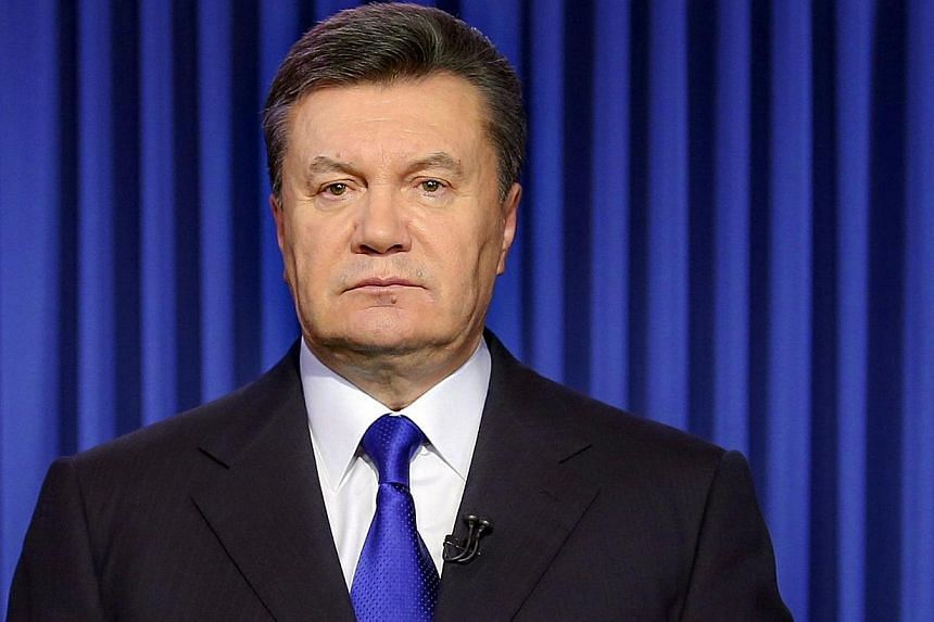 """Ukraine's President Viktor Yanukovych speaks in Kiev on Feb 19, 2014 during an address to the nation. Yanukovych said anti-government protesters had """"crossed the limits"""" by taking to the streets to try to oust him from power as deadly clashes raged i"""