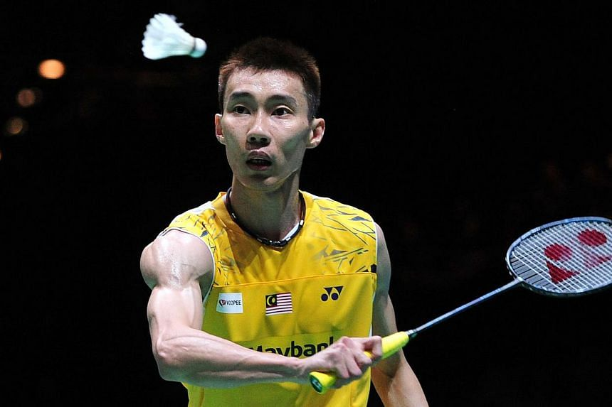 Lee Chong Wei of Malaysia returns against Chen Long of China in their All England Open Badminton Championships men's singles final match in Birmingham, central England, on March 9, 2014. -- PHOTO: AFP