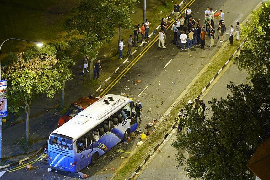 The wrecked private bus at the junction of Race Course Road at the aftermath of the Little India riot on Dec 9, 2013. -- ST FILE PHOTO: ALPHONSUS CHERN