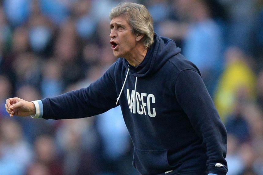 Manchester City's Chilean manager Manuel Pellegrini gestures from the touchline during the English FA Cup quarter-final football match between Manchester City and Wigan Athletic at the Etihad Stadium in Manchester, north-west England, on March 9, 201