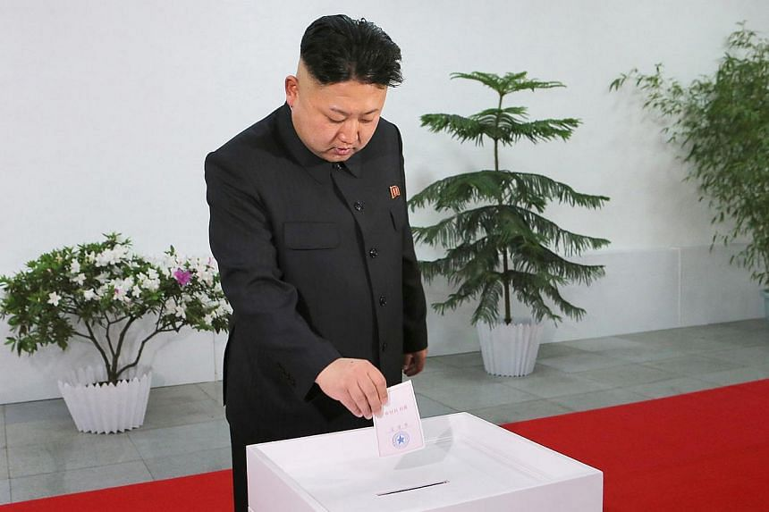 North Korean leader Kim Jong Un casting his ballot in the election of a deputy to the Supreme People's Assembly at sub-constituency No. 43 of Constituency No. 105 together with service personnel of North Korean army at Kim Il Sung University of Polit