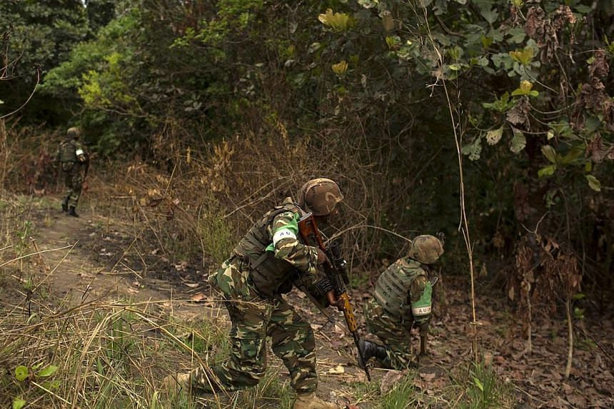 African Union (AU) peacekeepers pursue possible Christian anti-Balaka militia men who tried to attack a group of ethnic Muslim Peuls, near the town of Bouar, west of the Central African Republic, March 9, 2014.A group of UN-mandated investigato