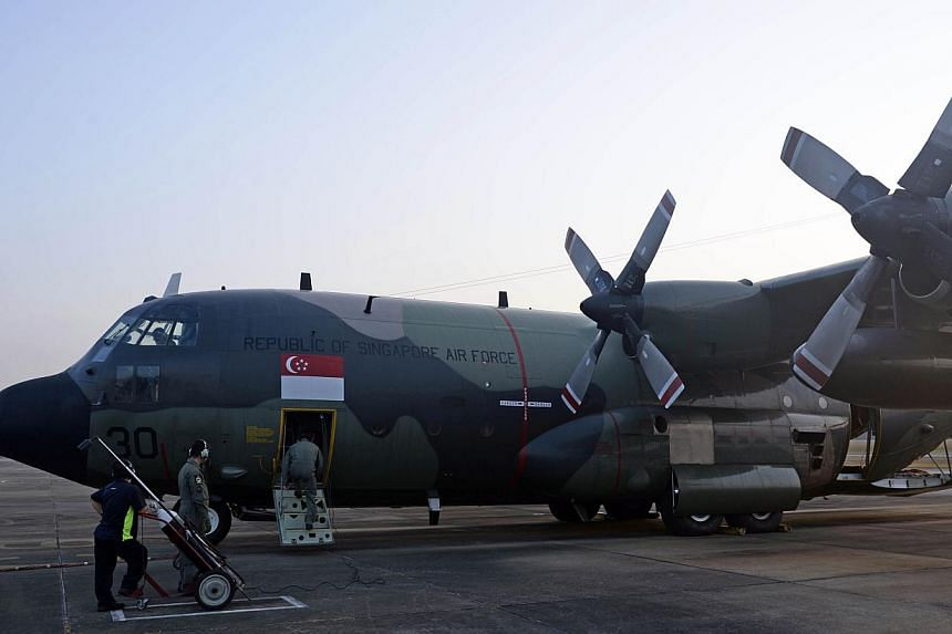 This RSAF C-130 aircraft, with an 18-member crew, spent about 10 hours on a mission to locate the missing Malaysia Airlines plane on March 9. -- ST PHOTO: DESMOND LIM