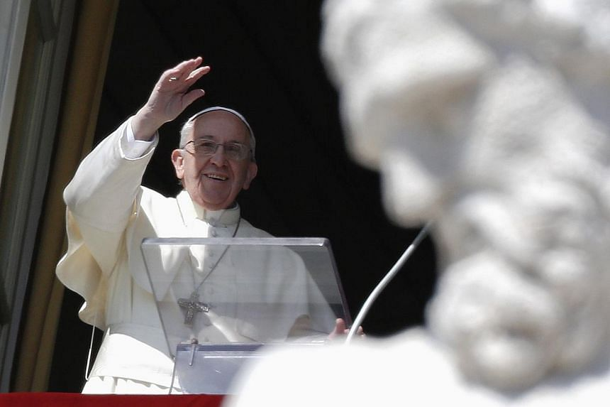Pope Francis waves as he leads the Angelus prayer from the window of the Apostolic palace in Saint Peter's Square at the Vatican on March 9, 2014. -- PHOTO: REUTERS