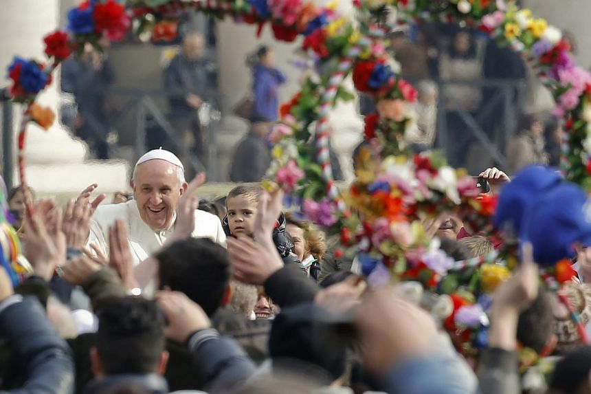 Pope Francis arrives to lead his Wednesday general audience in Saint Peter's Square at the Vatican on Feb 26, 2014. -- FILE PHOTO: REUTERS