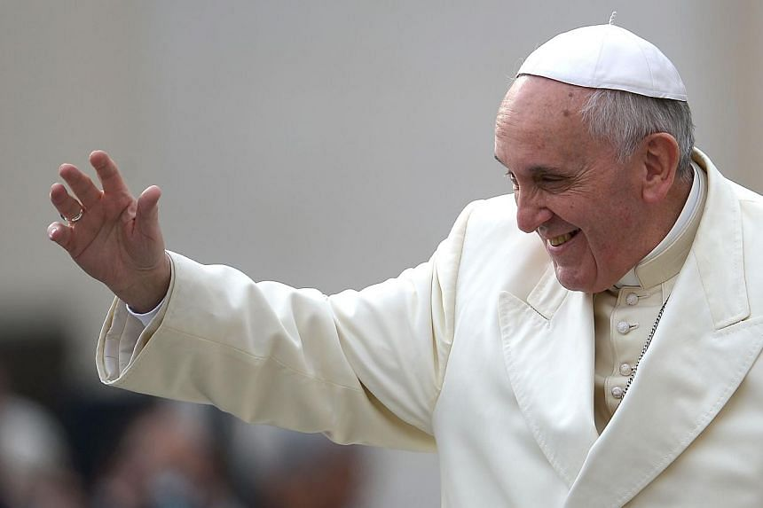 Pope Francis waves as he arrives for his general audience in St Peter's square at the Vatican on Feb 26, 2014. -- FILE PHOTO: AFP