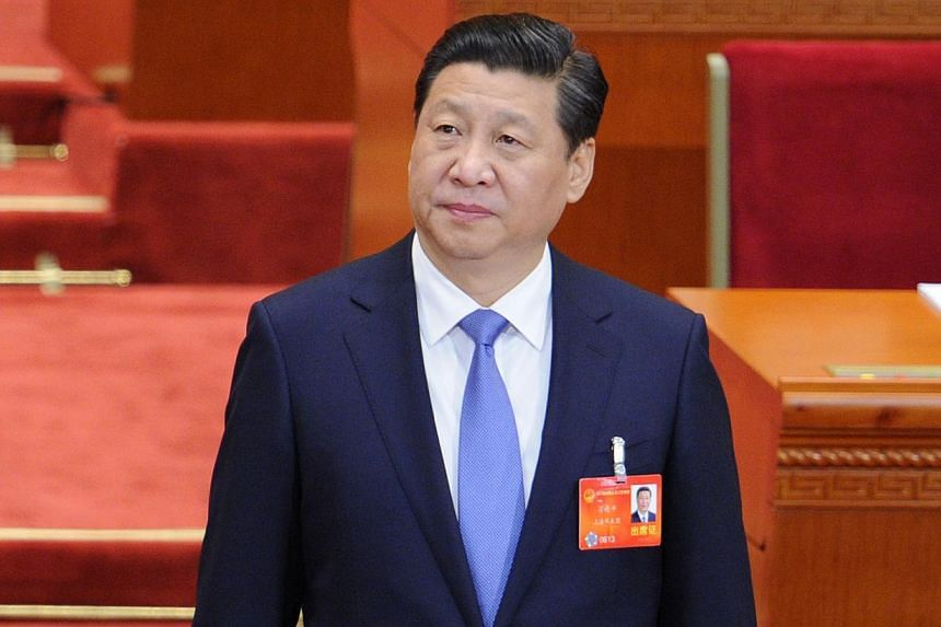 Chinese President Xi Jinping arrives at the opening session of the 12th National People's Congress (NPC) in the Great Hall of the People in Beijing on March 5, 2014. -- FILE PHOTO: AFP