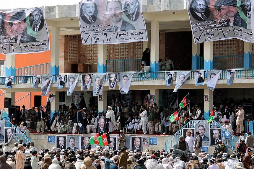 Supporters of Afghan presidential candidate Mohammad Nadir Naeem listen during an election rally in Kandahar on March 8, 2014.The Taleban on Monday vowed to target Afghanistan's presidential election, urging their fighters to attack polling sta