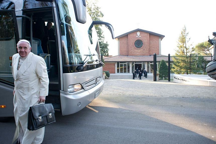 This handout picture released on March 10, 2014, by the Vatican press office shows Pope Francis arriving by bus on March 9, 2014, for a retreat in Ariccia near Rome.Pope Francis will make his first trip to Asia in August, visiting South Korea f