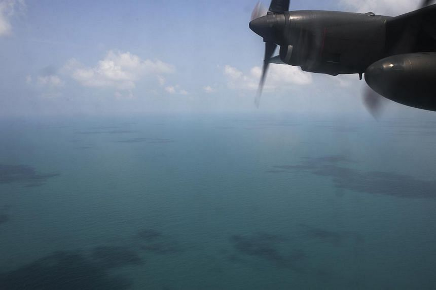 The view of the vast South China Sea from a Republic of Singapore Air Force C-130 plane deployed on March 9, 2014 to help in the search for a Malaysia Airlines Boeing 777 that went missing in the area a day earlier. -- ST PHOTO: DESMOND LIM