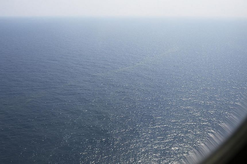 The view of the South China Sea about 140 nautical miles north-east of Kota Baru, Malaysia, from inside the RSAF C-130 on March 9, 2014. The RSAF deployed the plane on a 10-hour search-and-rescue mission to try to locate the missing Malaysian Airline