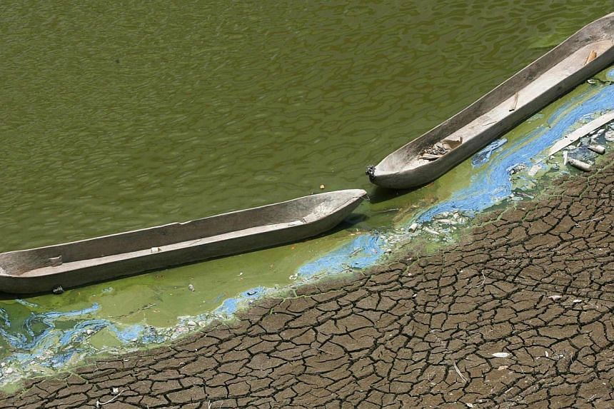 Wooden boats sit at the base of a dried-up reservoir, due to the long dry season, at Kedung Sumber village, near Bojonegoro Indonesia's East Java province, Oct 16, 2013. There is a greater possibility of an El Nino weather pattern emerging this