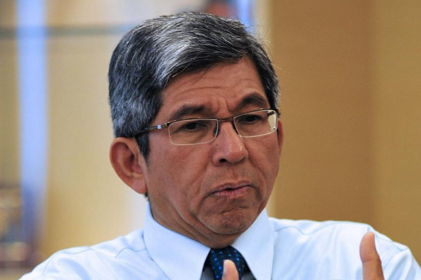 "Minister for Communications and Information Yaacob Ibrahim said there are ""concerns"" over unfair practices. -- BH FILE PHOTO: TUNI SHARIFF"