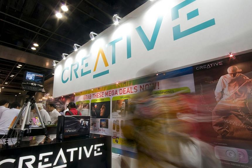 Crowds of people walk past Creative Technology's booth at the IT show in Singapore, on Friday, March 7, 2008. -- PHOTO: BLOOMBERG