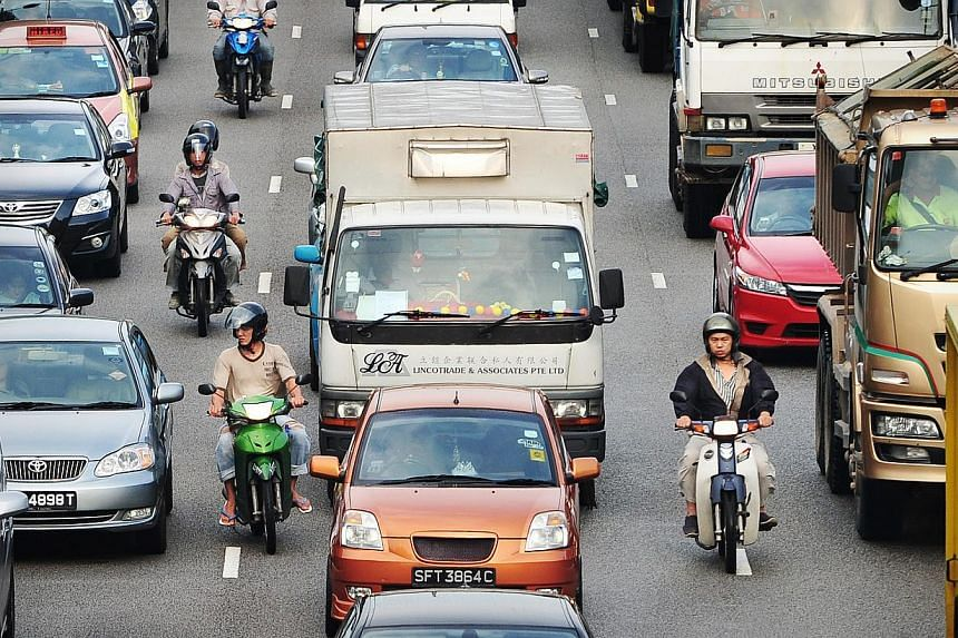 The Government has enhanced a year-old scheme that encourages owners to replace their aging and pollutive diesel commercial vehicles. -- ST FILE PHOTO: ALPHONSUS CHERN
