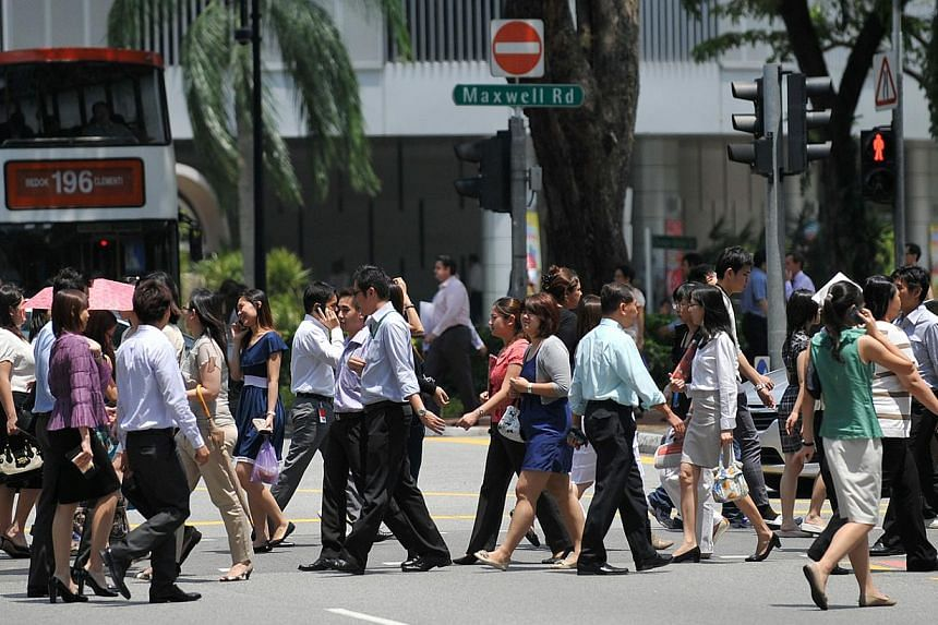 Office workers crossing Maxwell Road in the central business district (CBD) area on Aug 10, 2011. -- ST FILE PHOTO:JOYCE FANG
