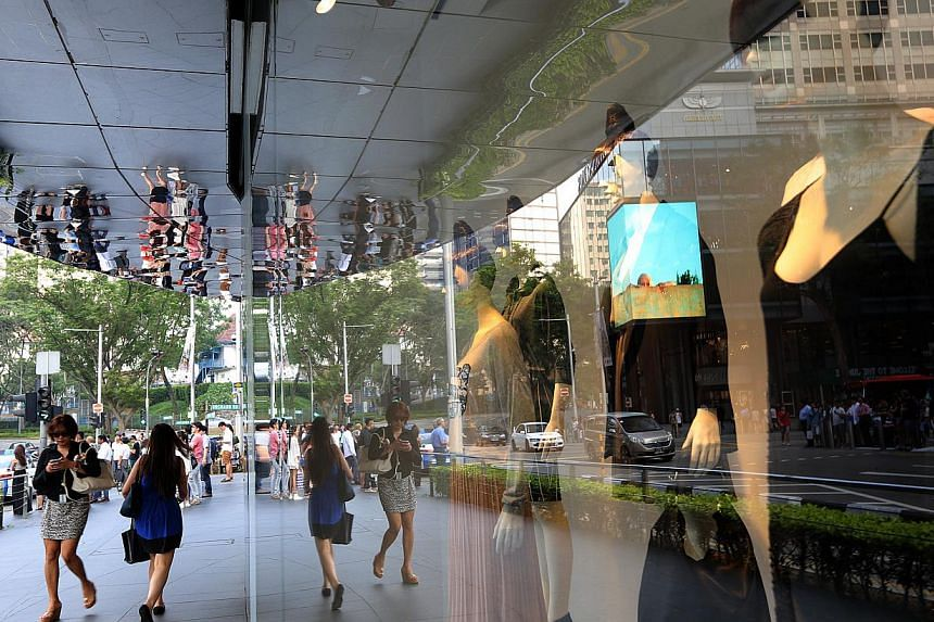 The EIU survey found that Singapore is the most expensive place in the world to buy clothes, but its focus was on high-end stores. For high-street brands such as H&M (above) that are popular here, local shoppers seem to be getting a better deal on so