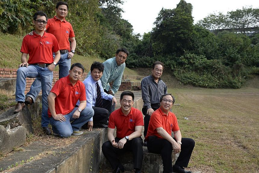 Former Hua Yi students (from left, back, standing) Tan Kok Boon, 45, and Kenny Sim, 44; (second row) Anston Tan, 39; Wang Xiang Qin (wearing a tie), 52, and Cai Yiren, 49; (on the ground) Michael Chia, 43, Huang Qing Yuan (in stripes), 68, and Benny