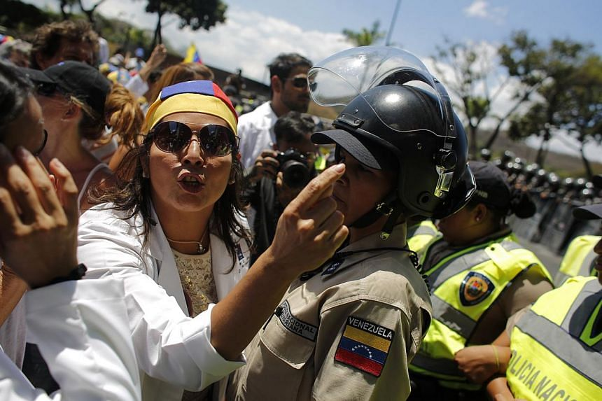 An anti-government doctor yells as national policemen block a march to demand medical supplies for hospitals in Caracas on March 10, 2014. -- PHOTO: REUTERS