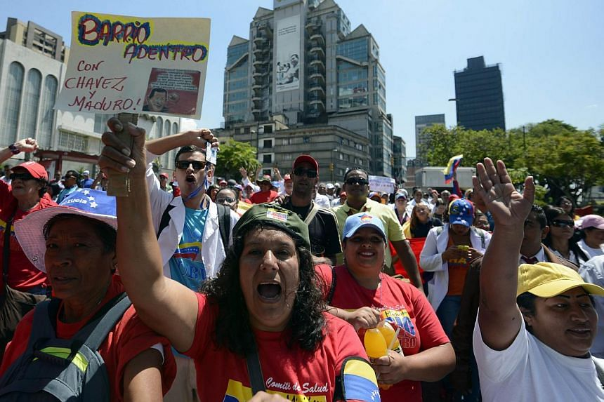 Health workers march to the presidential palace to show their support to President Nicolas Maduro, in Caracas, Venezuela, on March 10, 2014. Hundreds of doctors and medical students protested conditions in Venezuela's hospitals on Monday, citing shor
