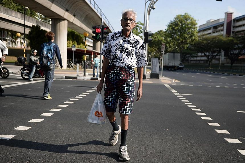 Mr K. Rajandra, 83, a Yishun resident, on 11 March, 2014. The Land Transport Authority (LTA) will introduce new safety zones in five housing estates by the end of this year, in a bid to make the roads safer for elderly pedestrians. -- ST PHOTO:
