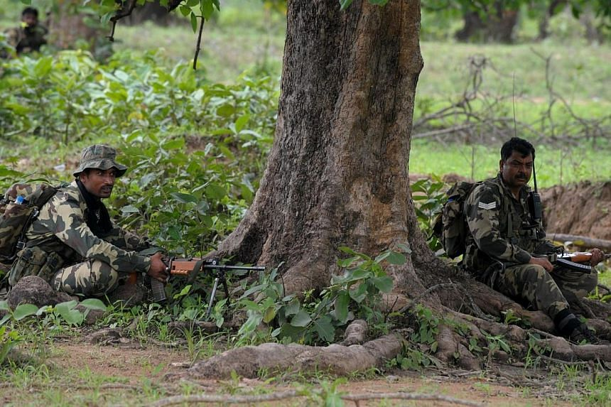 In this photograph taken on July 7, 2012, Indian Central Reserve Police Force (CRPF) personnel mount a patrol outside the village of Kothaguda in Bijapur District, after an encounter between Maoist rebels and security forces in the central Indian sta