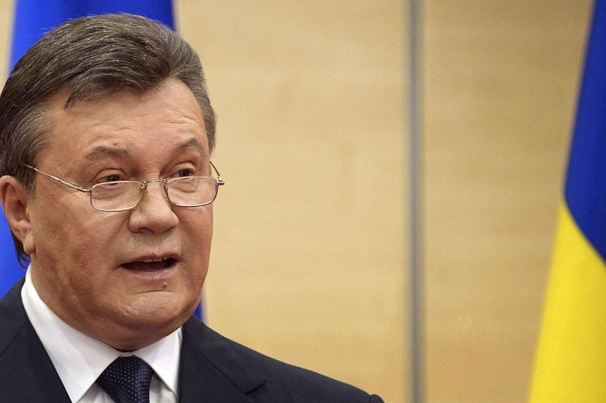 Deposed Ukrainian president Viktor Yanukovych speaks at his press-conference in southern Russian city of Rostov-on-Don, on March 11, 2014. Ousted Ukrainian leader Viktor Yanukovych on Tuesday, March 11, 2014, said that he was still the country'
