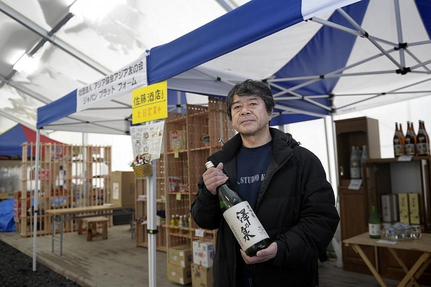 STARTING OVER: Mr Kote Sato, 52, lost his home and liquor shop business when the tsunami swept through Utatsu in Minami-sanriku, Miyagi prefecture. But now with the help of friends and an NGO, he has started another shop in a covered market that sits