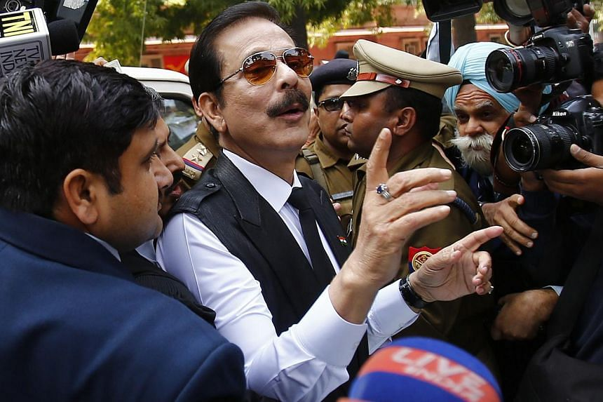 The Sahara group chairman Subrata Roy (C) at the Supreme Court in New Delhi March 4, 2014. Roy, the head of India's Sahara conglomerate, was arrested on Friday after failing to appear at a Supreme Court hearing related to a multi-billion-dollar Sahar