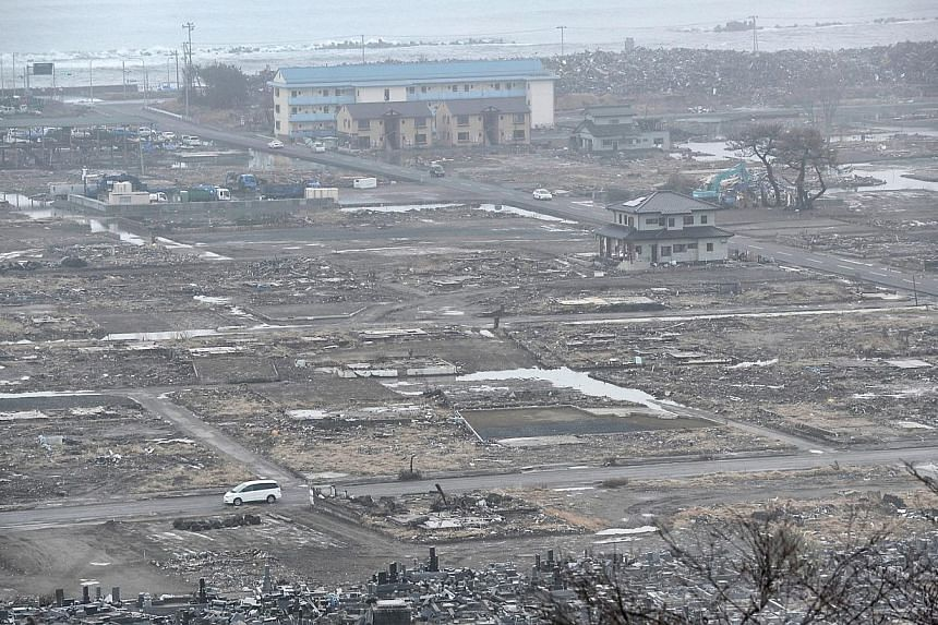 REMAINS OF THE DAY: Okawa Elementary School in Ishinomaki, Miyagi prefecture, where 74 pupils were killed when a wave breached the protective dyke and engulfed them. One year on, work to clear the debris of the community has nearly been completed. Th