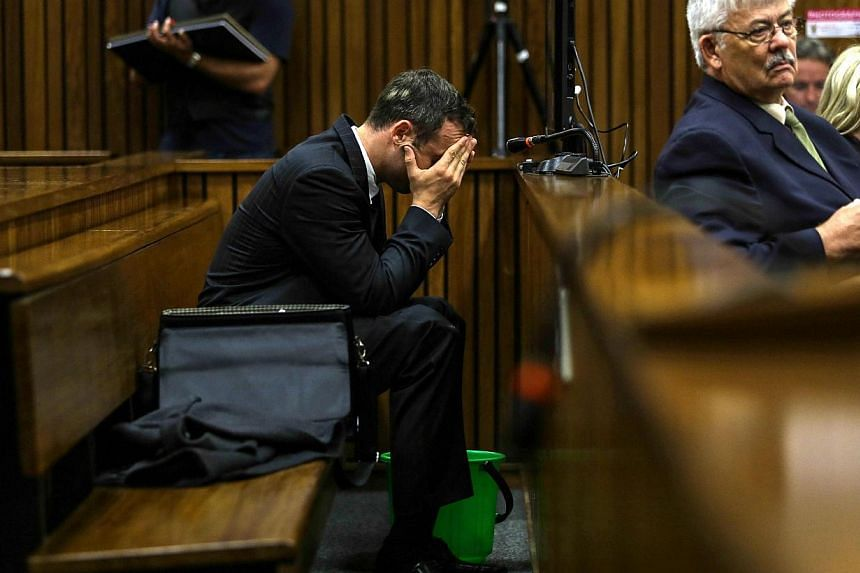 South African Paralympic athlete Oscar Pistorius attends his ongoing murder trial at the North Gauteng High Court on March 11, 2014, in Pretoria.Pistorius's defence lawyers on Tuesday probed a pathologist's explosive testimony that Reeva Steenk
