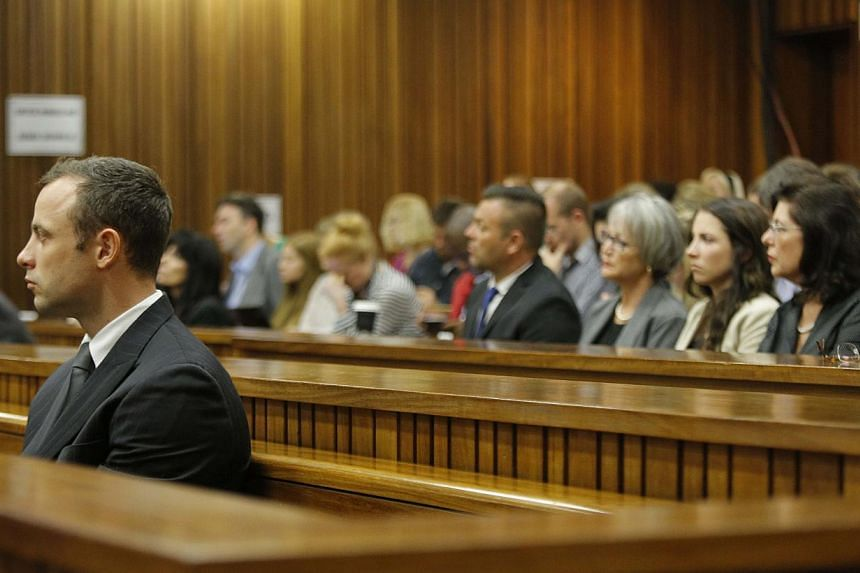 South African Paralympic athlete Oscar Pistorius attends his ongoing murder trial on March 11, 2014, in Pretoria. Pistorius was passionate about guns, a friend testified on Tuesday, telling the court how the Paralympian had fired a gun through a sunr