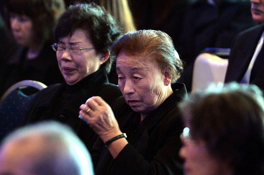 Residents of Namie who were evacuated from their hometown cry at a memorial service near the stricken Tepco Fukushima nuclear plant in Fukushima prefecture on March 11, 2014, the third anniversary day of the massive earthquake and tsunami that hit no