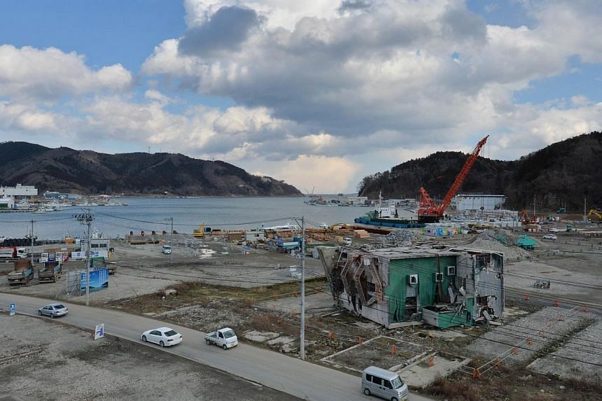 The devastated fishing port in Onagawa, Miyagi prefecture on March 10, 2014, a day before the third anniversary of the massive earthquake and tsunami disaster in Japan. -- PHOTO: AFP