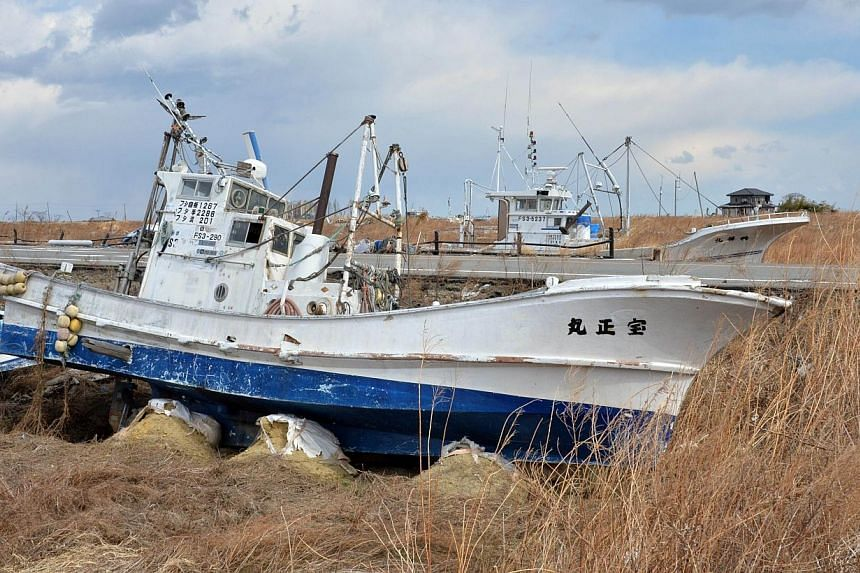 Grounded fishing boats in Namie, near the striken Fukushima nuclear plant, are still abandoned three years after the March 11, 2011 earthquake-tsunami disaster in Japan. -- PHOTO: AFP