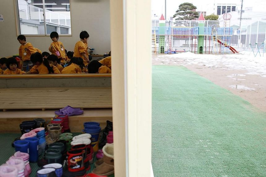 Children playing at an indoor sand pit of the Emporium kindergarten in Koriyama, west of the disaster-stricken Fukushima nuclear power plant, on February 28, 2014. -- REUTERS