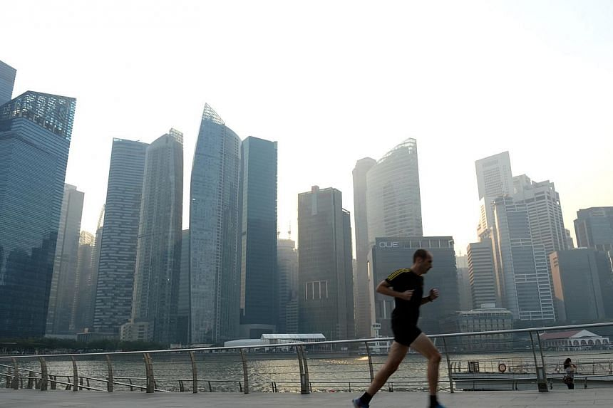 Haze at the Marina bay area at 6pm on Tuesday, March 11, 2014.Hazy conditions on Tuesday evening were due to hot spots in southern Johore, and PSI and fine particle readings are expected to be moderate for the next 24 hours, the National Enviro