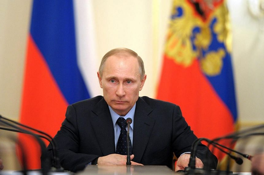President Vladimir Putin has seen his approval rating climb in Russia due to his strong stance on military intervention in Ukraine, several opinion polls show. -- FILE PHOTO: AFP