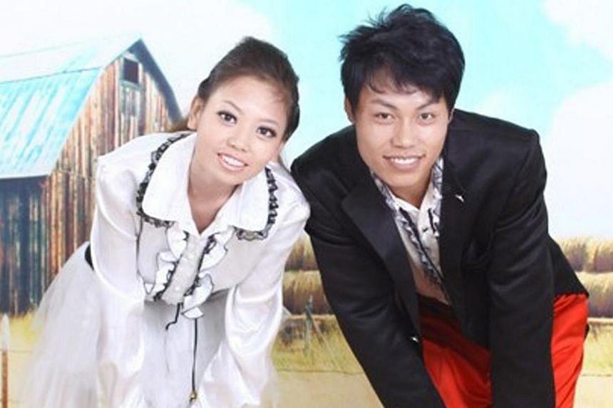Zhao Peng, seen here with his wife, Zhang Jing.