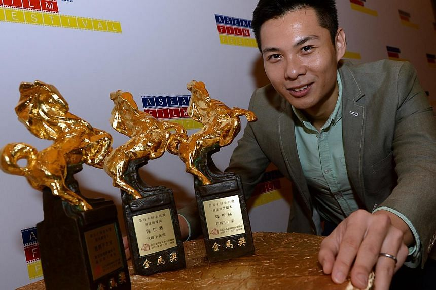 Local film director Anthony Chen with the Golden Horse awards he won for his highly-acclaimed movie Ilo Ilo. To build on successes such as Ilo Ilo, MCCY will work with the Foreign Affairs Ministry to promote local art abroad. -- ST FILE PHOTO: CHOO C