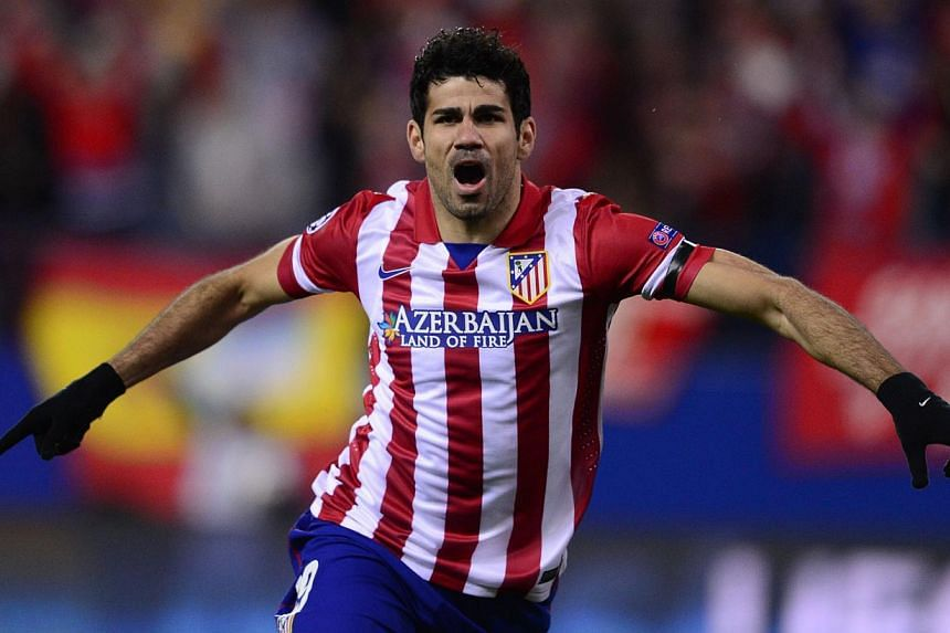 Atletico Madrid's Brazilian-born forward Diego da Silva Costa celebrates after scoring their first goal during the UEFA Champions League quarter-finals second leg football match Club Atletico de Madrid vs AC Milan at the Vicente Calderon stadium in M