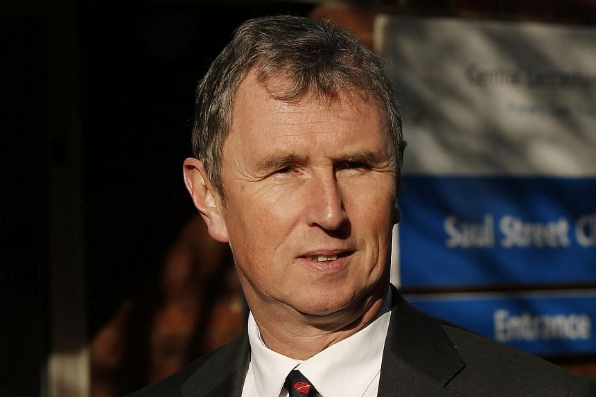 British Conservative MP and former Deputy Speaker of the House of Commons, Nigel Evans, arrives at Preston Crown Court northern England, on March 10, 2014. Evans appeared at court on Monday charged with sexual offences against men. -- FILE PHOTO: REU
