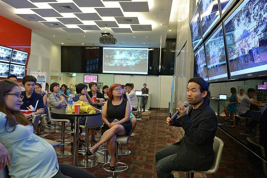 Award-winning photographer Stefen Chow speaking at gaming  venue Livewire in Marina Bay Sands about how he decided to pursue photography as a career after he scaled Mount Everest in 2005.
