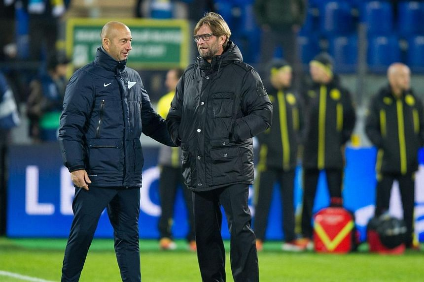 Borussia Dortmund's head coach Juergen Klopp (right) speaks with Zenit Saint Petersburg's head coach Luciano Spalletti before their UEFA Champions League Champions League last 16, first-leg football match at Petrovsky Stadium in Russia's second