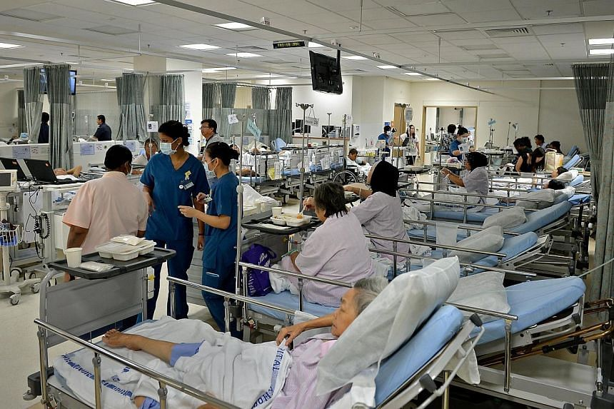 Patients waiting for a bed on Jan 10, 2014, at Khoo Teck Puat Hospital's emergency department, which has 18 cubicles. The recent hospital bed crunch raises serious questions about patient safety and the adequacy of health-care infrastructure, said