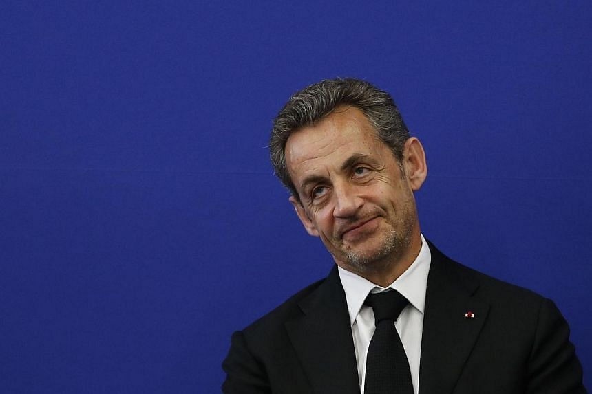 Former French president Nicolas Sarkozy attends the inauguration of the Claude Pompidou Institut, a new centre for care and research of Alzheimer disease, on March 10, 2014 in Nice, southeastern France. A scandal that initially landed former French l