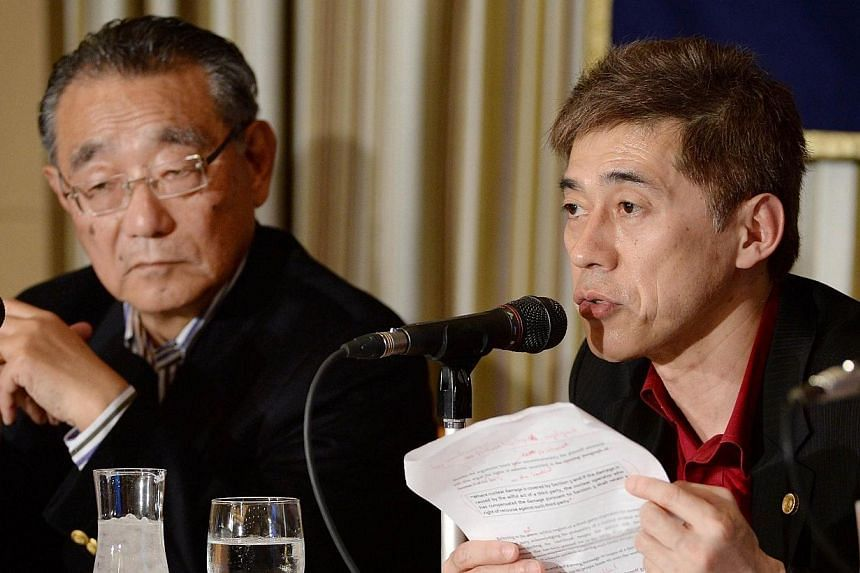 Akihiro Shima, chief attorney for a lawsuit against nuclear power plant suppliers, speaks to journalists beside Choi Sung-Koo, secretary general of reactor suppliers lawsuit plaintiff team, during a press conferende at the Foreign Correspondents' Clu
