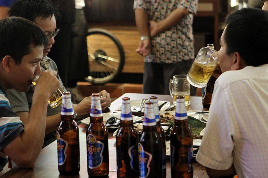 People drinking beer at a coffeeshop in Smith Street. A survey into purported unfair beer pricing found that of 16 food and beverage outlets in Singapore, only three did not raise prices above the calculated excise increase stated by the Minist