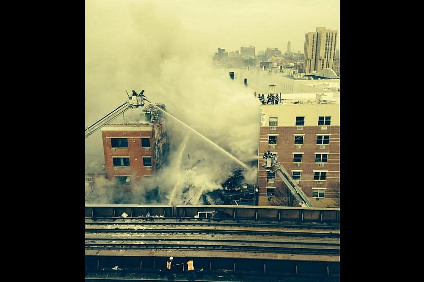 A residential building in New York's East Harlem neighbourhood exploded and collapsed on Wednesday, sparking a serious fire, officials said.-- PHOTO: FROM NEW YORK FIRE DEPARTMENT'S TWITTER